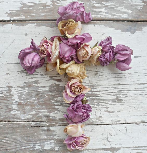 cross and purple roses